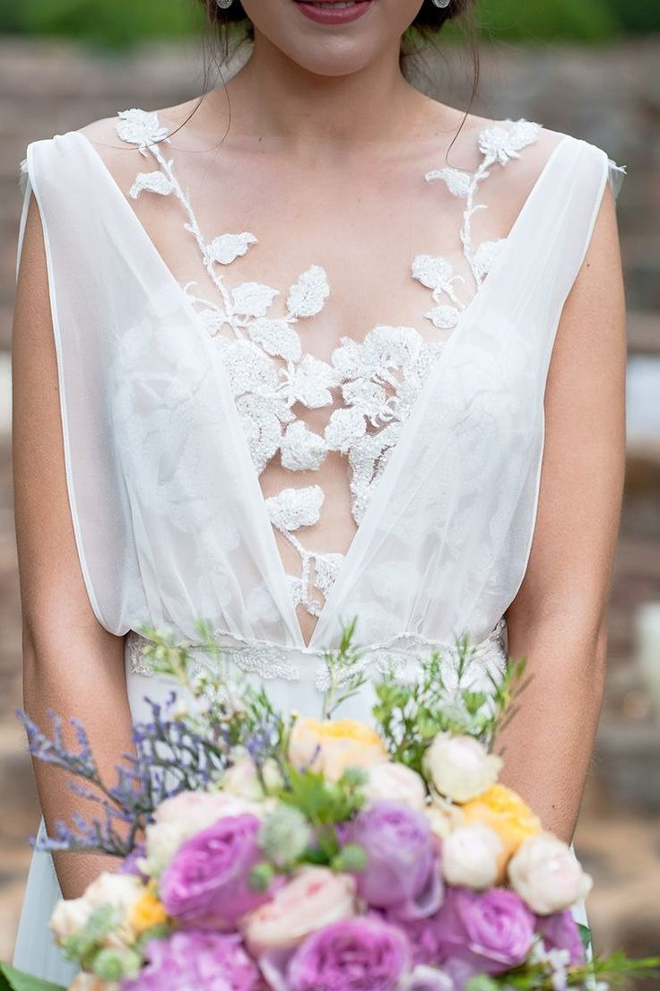 This ethereal wedding dress is perfect for your summer garden wedding. And the details are to die for!