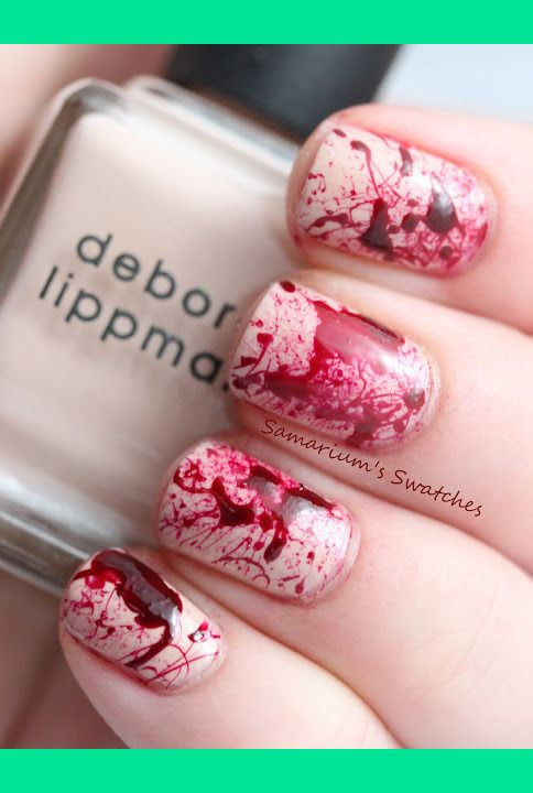 Halloween Blood Nails-You can get this effect by using a straw, picking up the polish and blowing it onto your nails.