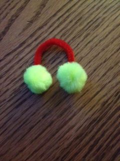 Girlscout Thinking Day Swaps for Norway. My Junior Girlscouts made these with just Pom Poms and pipe cleaners. You can mix and match colors or even twist 2 different colors of pipe cleaners. We hot glued the Pom Poms to the cleaners. Very fun and cheap swap for the girls. Makes cute ear muffs :)