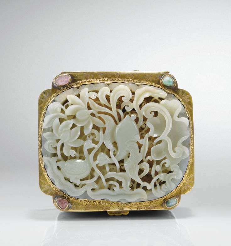 a well carved and pierced pale celadon jade plaque ming