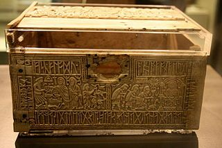 This is the Franks Casket, a small box crafted sometime around the 7th century CE.  It has a strange juxtaposition of scenes, including the Adoration of the Magi, Wayland the Smith, and Romulus and Remus; Christian, Norse, and Roman mythology are all mixed together. The artifact now resides in the British Museum.