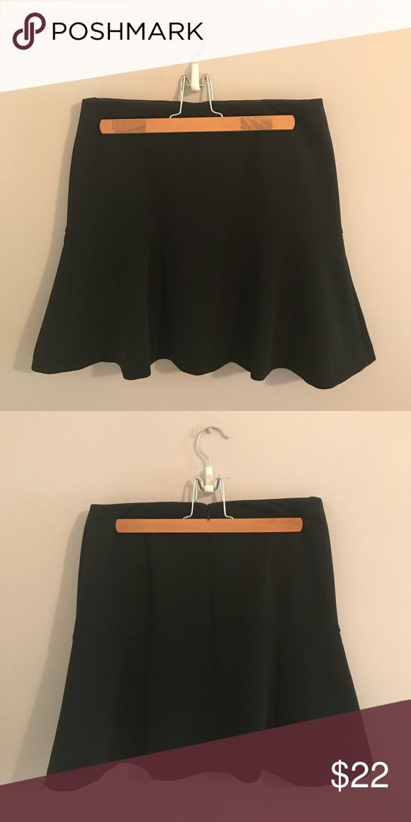Ann Taylor peplum skirt Ann Taylor women's black peplum skirt. 94% polyester, 6% spandex. Lining is 100% polyester. Very chic and classic; pairs nicely with heels, ballet flats. Pair with a graphic tee for a street-chic look, or with a blouse and sweater or blazer for an office look. Ann Taylor Skirts