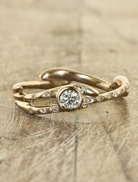 If these rings weren't SO DAMN EXPENSIVE this would be perfect. Interesting, organic, and not huge. Thank you.