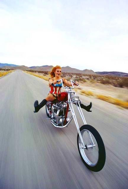 ann-margret..great pic..love the easy rider/wonder woman outfit & chopper!