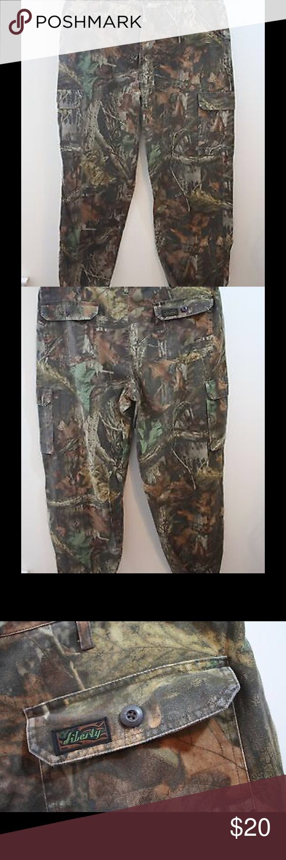 """Vintage RealTree Camo Mens Hunting Pants Size XL Vintage LIBERTY RealTree Camo Men's Hunting Pants Size: XL Reg Condition: Pre-Owned in great condition, see pictures for details Size: X-Large Regular 42-44 (Tag says 46-48 measures 42-44) Description: Vintage RealTree Camo Mens Hunting Pants Size XL Reg.  Has pockets in the legs, sides & back 6-TOTAL Draw tie in the leg. Adjustable side straps, zipper fly  Measurements: Waist: 42 Inseam: 32.5"""" Bottom Leg Width: 1019"""" Contents: Shell 36%…"""