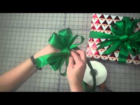 Learn how to make a 3 loop bow like a professional. Perfect for gifts that need to make a statement!    Visit www.LisasGiftWrappers.com for more creative gift wrapping inspiration or visit www.ReadySetWrap.com to purchase gift wrapping paper or other supplies