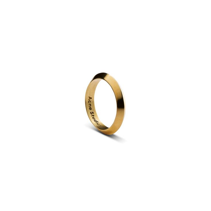 Acne Studios is a gold plated silver ring.