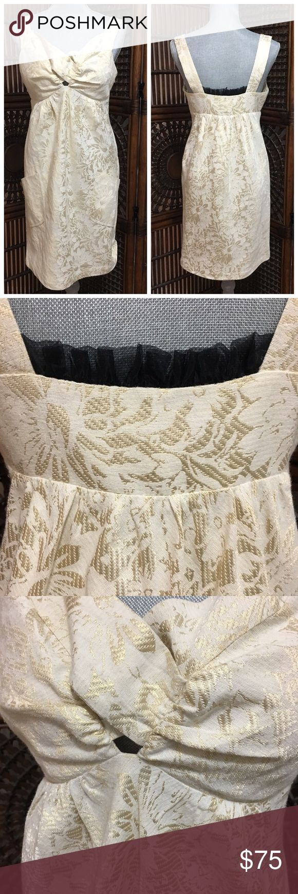 """BCBG gold and cream cocktail dress Beautiful cream and gold floral dress by BCBG. Fully lined. Side zipper. Amazing details! Black lace detail between straps on back and small keyhole opening on front. Front pockets. Never worn but there is one small, light smudge on the front of the dress (see pic). Length is approx 35.5"""" from shoulder to hem BCBG Dresses"""