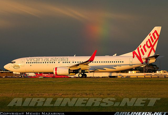 A brand new airplane, a brand new airline and a magnificent rainbow.