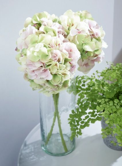 Green and pink faux hydrangea bouquet in tall vase. More at http://www.redonline.co.uk