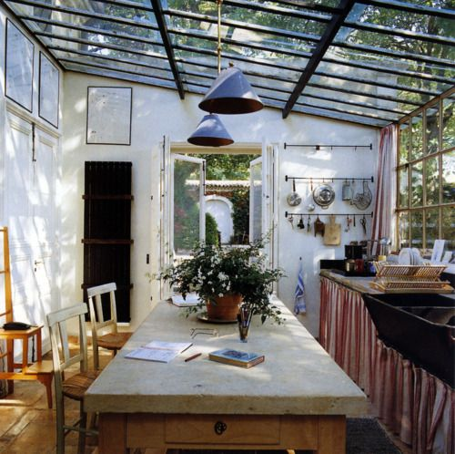 I love the glass ceiling and simplicity of this kitchen space. It feels like outside.