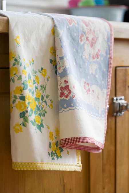 What a great idea! Turning sad but still lovely old tablecloths into dish towels. (Aprons would work, too, methinks.)