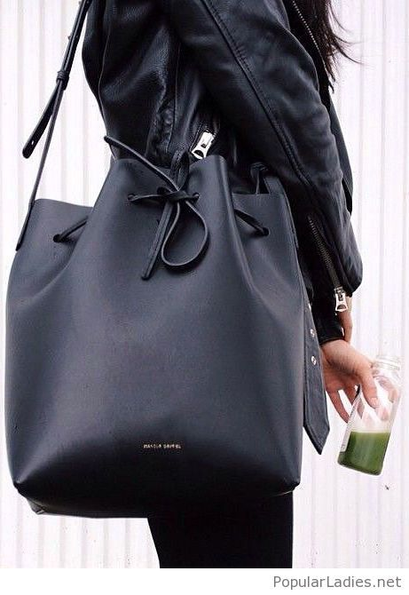 All black outfit with a nice bag