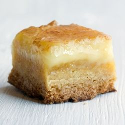 butter cake bars.    Ingredients    1 box of yellow cake mix (1 pound)  4 ounces of butter, melted  3 eggs  8 ounces of cream cheese, softened  1 pound (16 ounces) of powdered sugar  1 tsp. of vanilla extract    Prepare    1. Preheat oven to 350 F. Line an 8 x 8 inch pan with parchment paper.    2. Make the base first: mix together cake mix, butter