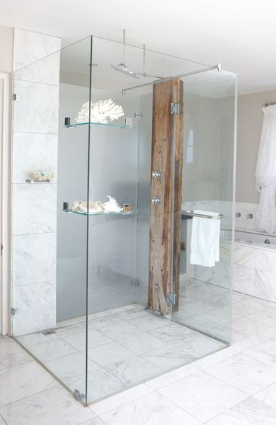 Seaside-inspired decorating ideas - Here, a selection of shells, some coral and timber bring nature into the bathroom – and the rough-textured sleeper is a striking base for the smooth chrome taps, also creating the perfect disguise for the necessary piping sandwiched between the two pieces of wood.