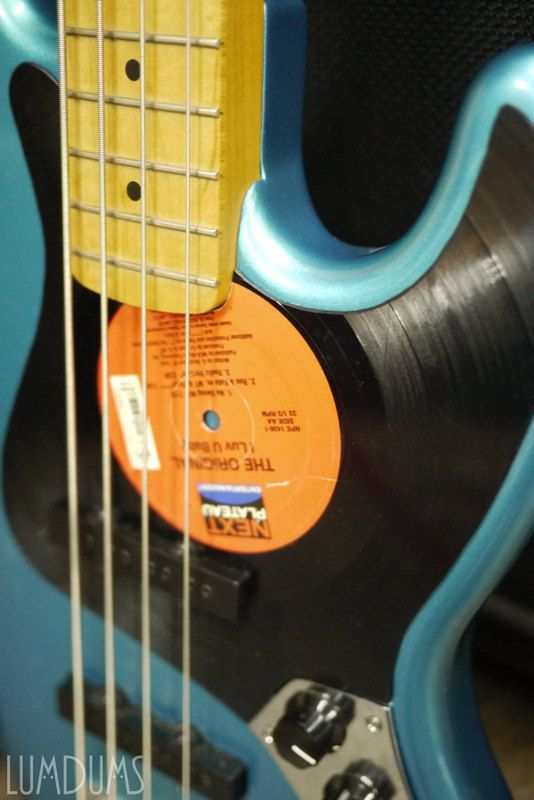 Custom Handmade Vintage Bass Guitar using a Vinyl Record as pick guard. #DdO:) - https://www.pinterest.com/DianaDeeOsborne/basses-of-life/ - BASSes of LIFE. Photo by LUMDUMS. Pinned via scalavera's #BASS #Pinterest board.