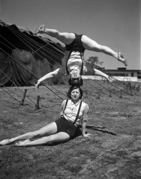 Acrobats just relaxing before the Ringling Circus starts...(ca. 1940).   Florida Memory