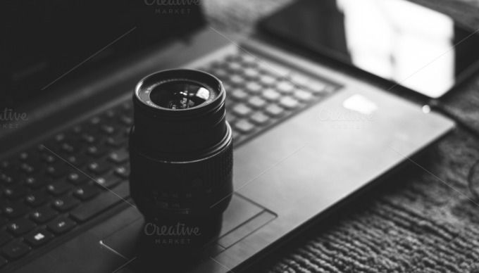 Check out Camera Lens on Laptop in B/W by Shots By RC on Creative Market