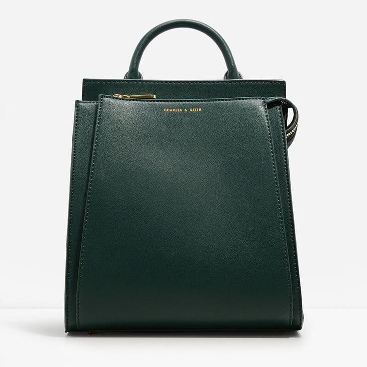 Large structured top handle bag with zip closure. Comes with an additional strap for versatility.