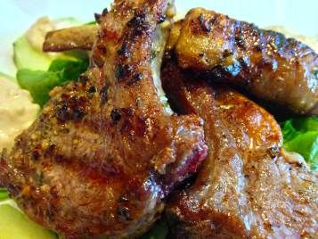 Lamb chops are marinated in a mixture of garlic, rosemary, Dijon mustard, oil, salt and pepper, then seared in the pan on both sides and finished cooking in the oven in this quick and easy healthy dinner recipe for a romantic entree.