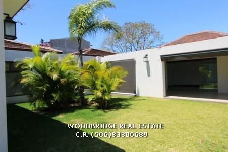 Costa Rica real estate luxury home in Santa Ana in gated community rent $6.500  sale $1.200.000 nice gardens, terraces,5 bedrs. 5.5 baths Woodbridge real estate CR mobile (506)83306689