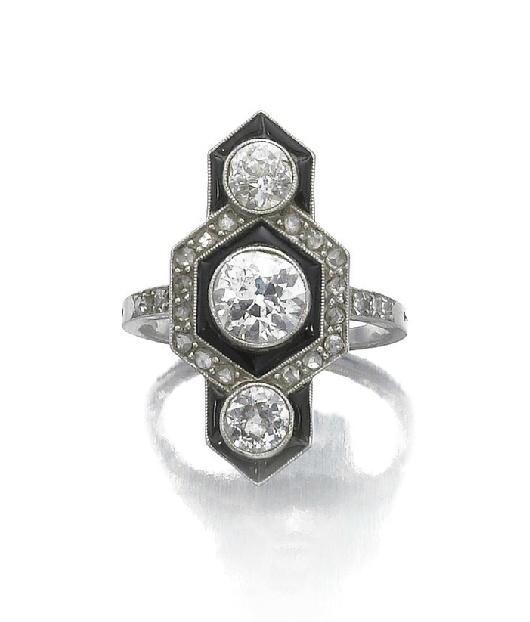 Onyx and diamond ring, circa 1920, set with circular cut diamonds, highlighted with enamel and rose diamonds
