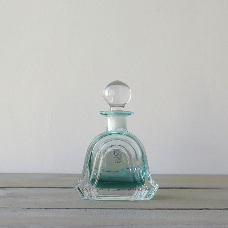 Aqua tinted lead crystal perfume bottle with stopper, would look lovely on your vanity! Labels by Collezione Glass Line Italy. The bottle is heavy with 24% lead crystal. In very good condition, no chi