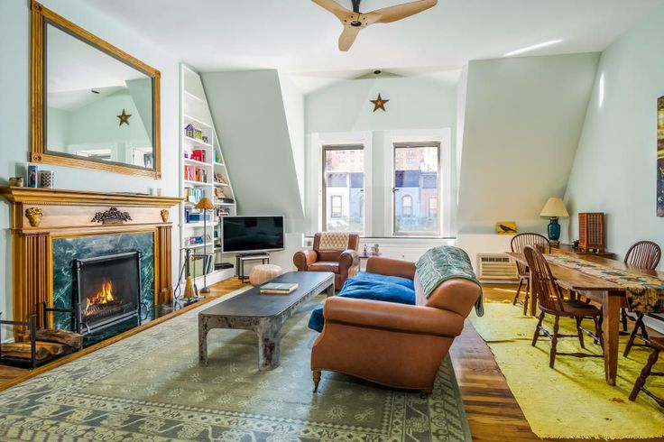 Amy Schumer's UWS Apartment Is Up For Grabs At Just Over $2M #refinery29  http://www.refinery29.com/2015/11/97390/amy-schumer-home-sale#slide-5  Another view of the room reveals space for a dining area behind the sofa. We love that Schumer's TV isn't the focal point of the space....