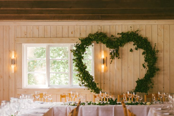Create a giant heart shaped wreath to frame where you're sitting at the reception. Julia Lillqvist | Sara and James | http://julialillqvist.com
