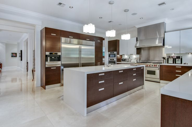 This sleek and modern kitchen makes meal creation both simple and enjoyable. Here you can find; rich wood, quartz, stainless steel finishes, and high-end appliances, and much more! #SupremeAuction #LuxuryAuction #Miami #CoralGables #MiamiMansion #MiamiRealEstate #Florida #FloridaRealEstate #ResortStyle #Auction #KoiPond #MediterraneanMansion