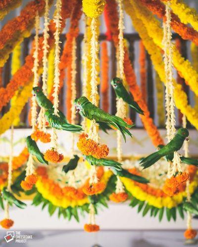 south Indian decor, parrot leaves, yellow genda flowers, birds decor
