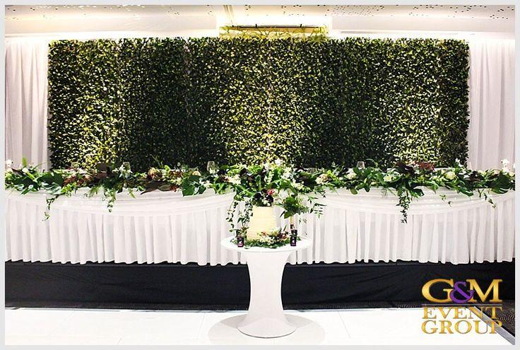 Rainforest inspired wedding reception at the Hilton Gold Coast - Bridal table with Uplighting and Cake Pin Spot | Surfers Paradise | #GMEventGroup #MCGlennMackay #DJBenShipway #Uplighting #EventLighting #Monogram #DJFacade #StarlightDanceFloor #RainForestTheme #PinSpot