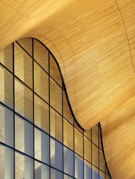 Interesting juxtaposition of curving wooden ceiling and the glass curtain wall. Kilden Performing Arts Center by ALA Architects.