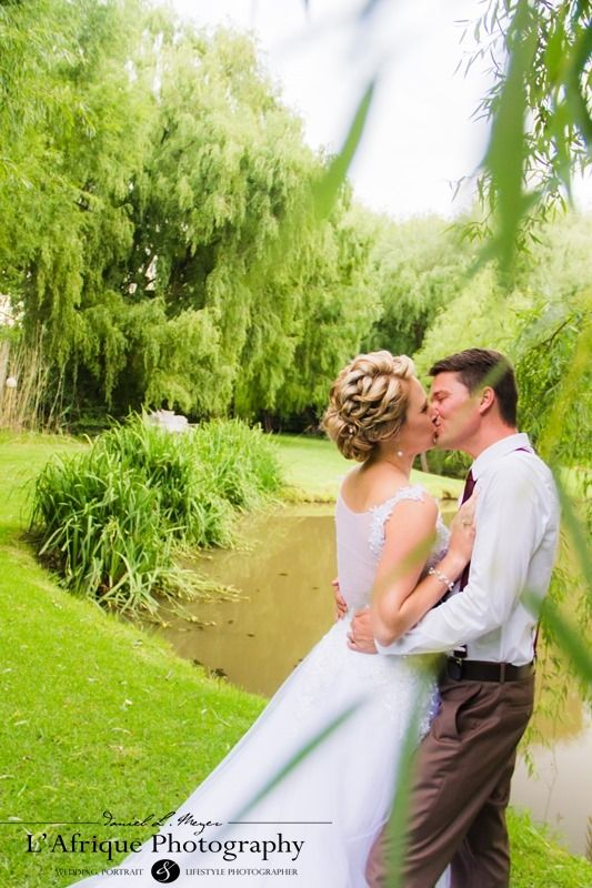 Reinard & Rozelda photo near the river at Fraaigesig wedding venue
