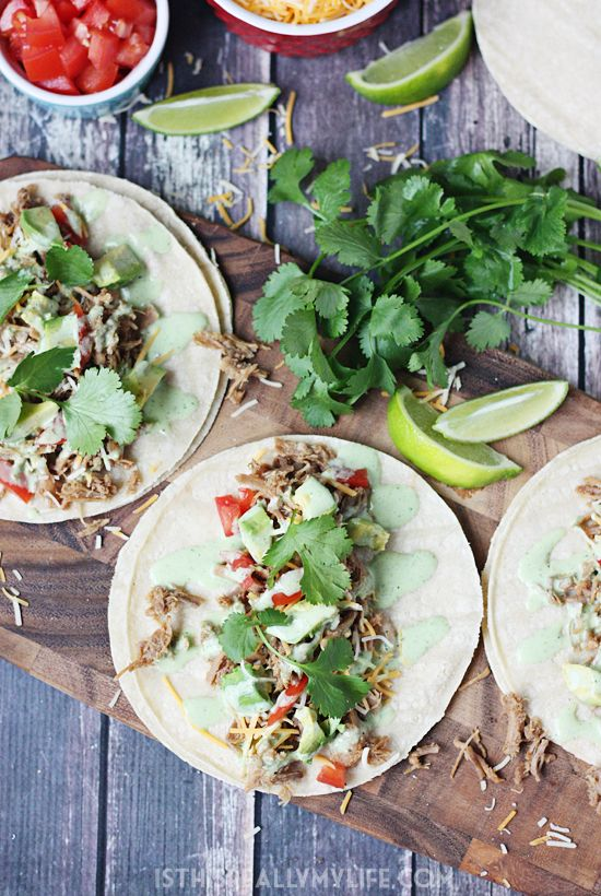 Pressure Cooker Cafe Rio Pork Tacos -- I took our favorite slow cooker Cafe Rio pork and converted it into an equally scrumptious pressure cooker Cafe Rio pork. Do not forget the creamy cilantro dressing! | isthisreallymylife.com