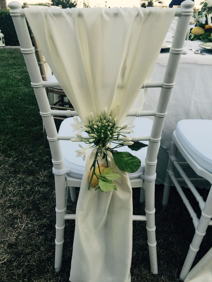white cover chair, lemon and white flowers, Sant'Eustachio, Villa Minuta, Scala, White, Yellow and Orange colors, Olga Studio, Sposa Mediterranea, Federica wedding Planner