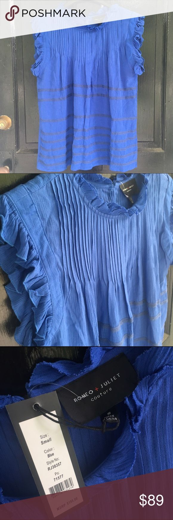 NWT Romeo + Juliet Couture Royal Blue top Super Feminine blue top with small ruffle and tucking and trim details. Also has 5 buttons on the back closure. 100% Rayon Romeo & Juliet Couture Tops Blouses