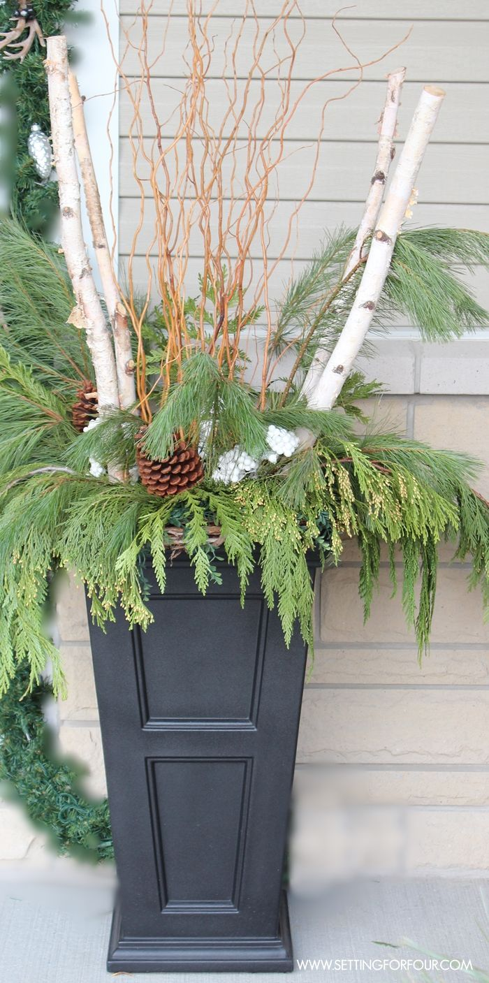 See my Christmas Entryway Decor with Winter Woodland Glam style! Front door wreath and garland decor, urns filled with greenery and birch. http://www.settingforfour.com