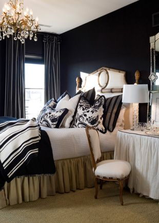{SK Tip} : When your room doesn't have architecture, match the drapery fabric to the wall color. The lines of the drapery become the architecture. Go custom and don't skimp on the drapery fullness here.  In this example the wall color is dark, but the concept works on light walls too.  Try it. -SK