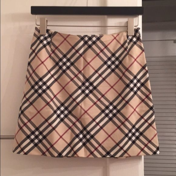 Burberry mini skirt 1 day sale!!! Size US 4 UK 6   Burberry mini skirt with side zipper. No longer fits & needs a new home =)   Retails for over $395. Please ask questions before buying. Don't like the price? Submit an offer & see if I'll take it. No low balling please. Burberry Skirts Mini