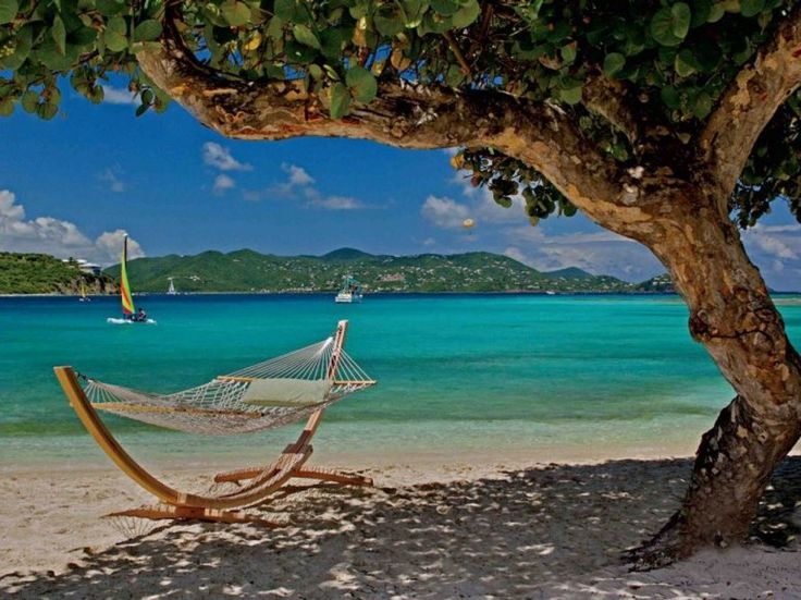 Beach at Ritz Carlton Hotel, St. Thomas, US Virgin Islands. This self-supporting swing doesn't technically need any trees to do its job, but having one nearby for shade—a native sea grape tree, at that—certainly doesn't hurt. Revel in the breeze as you gaze out over the Great Bay.