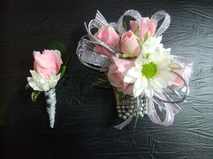 Cinderella-$50-Corsage with pink sweets, white daisies, white & silver ribbons, gems & greens and boutonniere to match