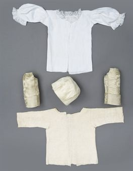 A GROUP OF INFANT'S COSTUME  18TH CENTURY  including a fine English knitted first shirt, linen with star-motif borders; a pair of child's silk damask sleeves; a silk plain cap; a white linen first shirt with lace collar and cuffs; and a white linen cap with ruffles; and a collection of whitework (a lot)