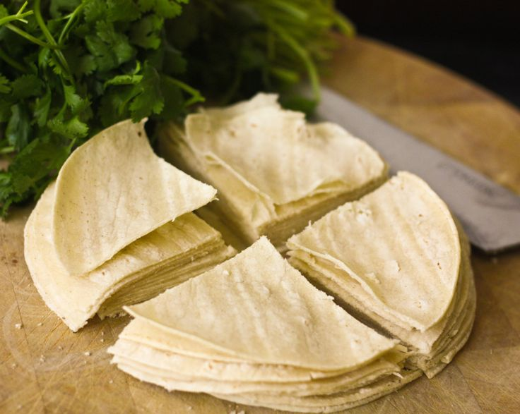 Baked tortilla chips are hard to find in these parts. I can go to a fancy schmancy grocery store that shall remain nameless and find a few brands, but they are generally quite expensive. However, s…