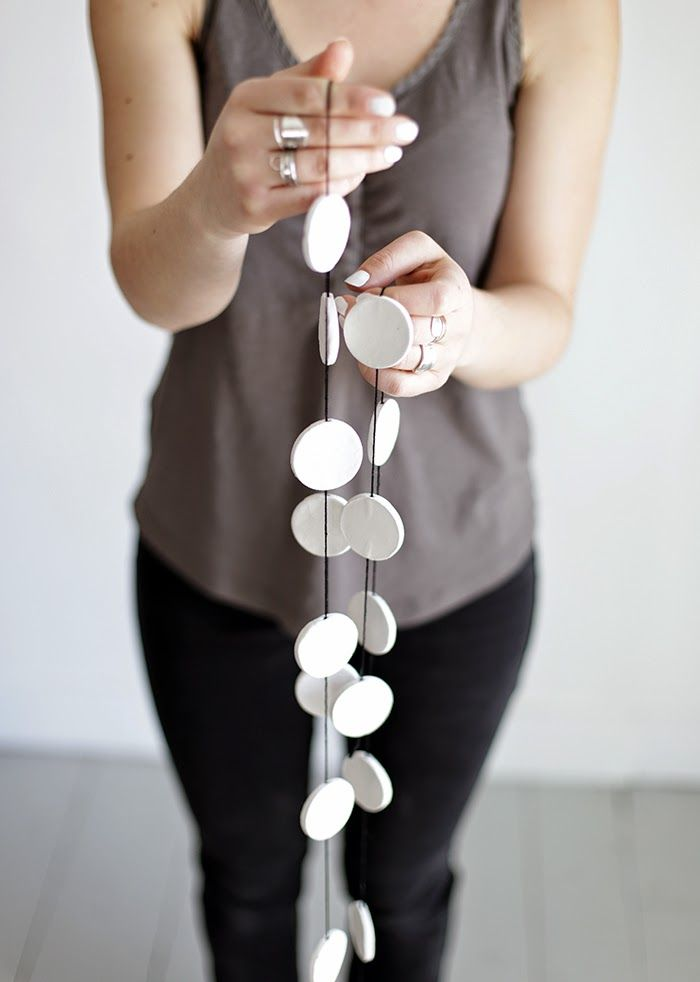 Poppytalk: #DIY Clay Circle Garland. This would make such a cute holiday decoration if they were all white!