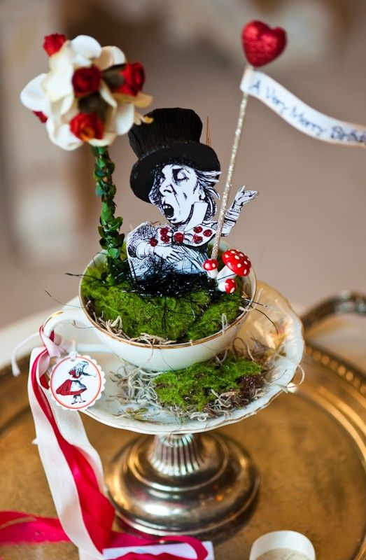etsy (overthetopstudios): mad hatter tea party in a cup. i thought these were really neat and had to share with you @Darin Krueger Montemayor ! probably not too hard to make either.