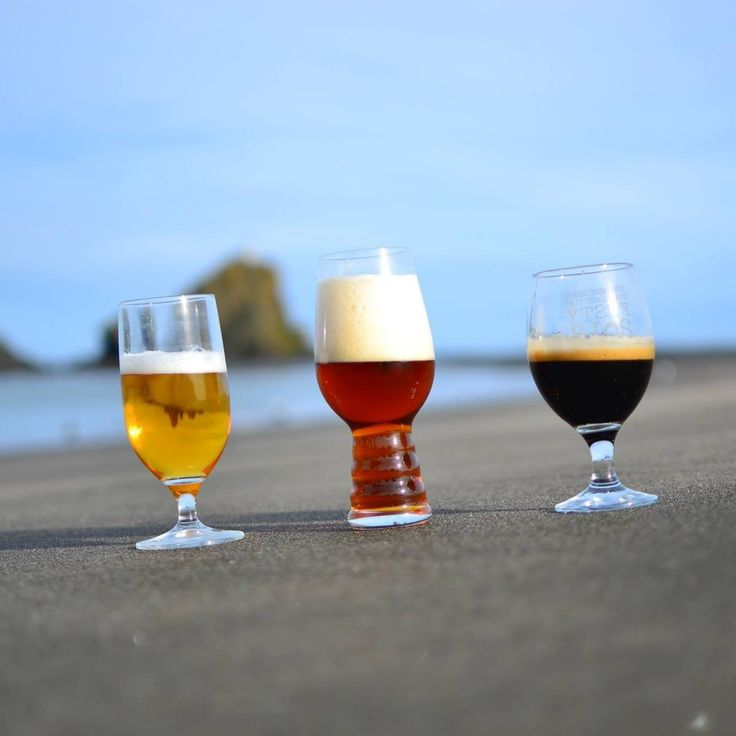 Outlier Cartel interview. beer on the beach.
