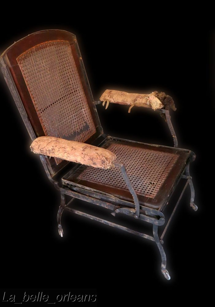 Antique victorian campaign folding iron lounge chair for Steam punk chair