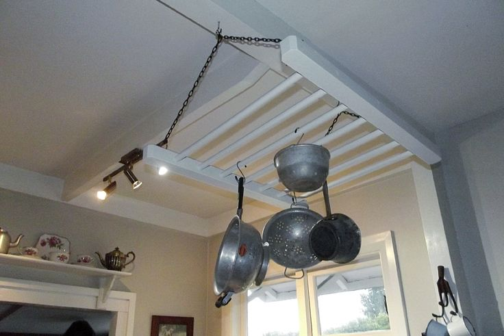 My husband made this hanging pot rack from an old cot end.
