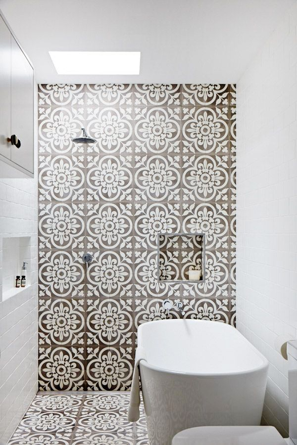 Patterned tiles on floor and feature wall create a wow effect.  Get this look at Suregrip Ceramics, 2A Gordon Avenue, Geelong West 3218